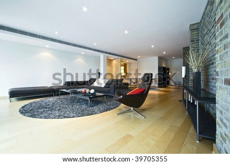 luxury living area with contemporary designer furniture - stock photo