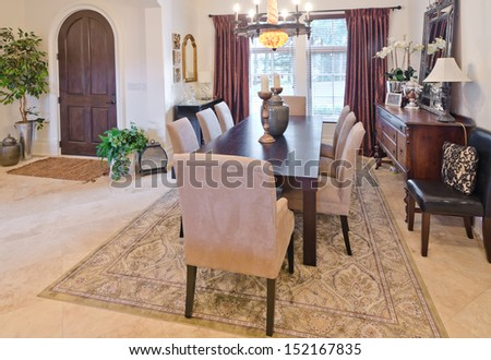 Luxury living, dining suite. Dining room and the lobby at the back. Interior design.