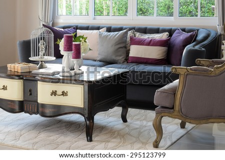 luxury living room design with classic sofa, armchair and decorative set on wooden table - stock photo