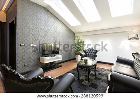 Luxury living room interior in the attic - stock photo