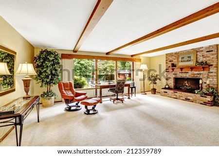Luxury living room with ceiling beams and brick fireplace - stock photo