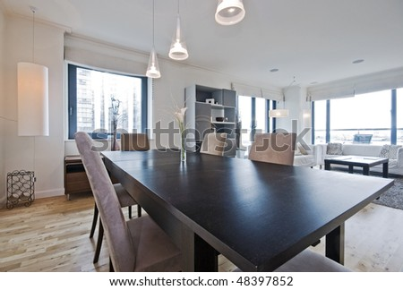 luxury living room with massive dining table - stock photo