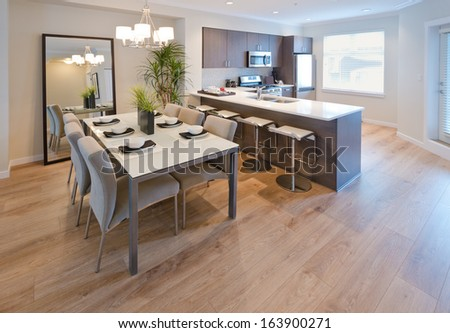 Luxury living suite : dining room and the kitchen at the back . Interior design. - stock photo