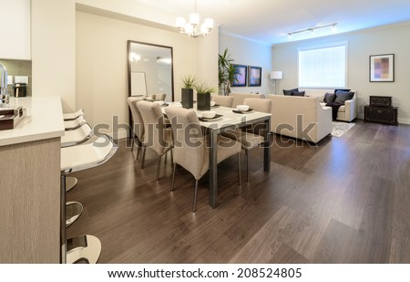 Luxury living suite : dining room and the living room at the back . Interior design. - stock photo