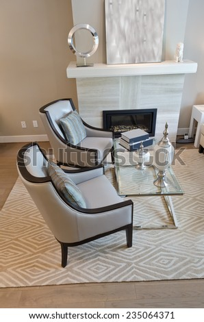 Luxury living suite: two modern chairs at the coffee table. - stock photo