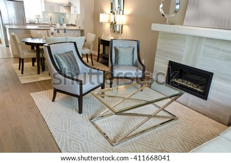 Luxury living suite: two modern chairs at the coffee table and the kitchen at the back. Interior design. - stock photo