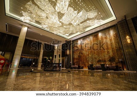 Luxury lobby interior.With crystal lamp,bing hall, marble floor, french sash,mosaic tile,comfortable sofa, etc. - stock photo
