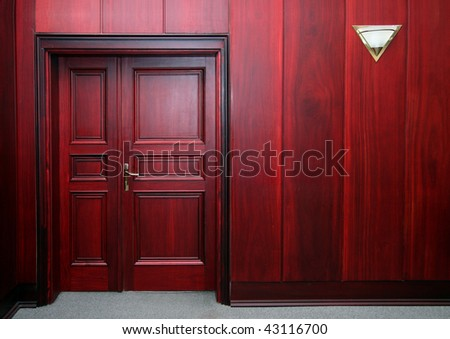 luxury mahogany wooden interior with closed door - stock photo