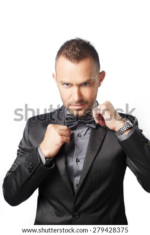 luxury man to repair his bow tie on white background  - stock photo