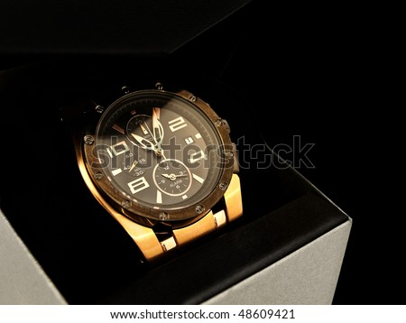 luxury man watch in gift box against black background - stock photo