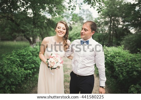 Luxury married wedding couple, bride and groom posing in park - stock photo
