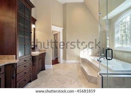 Luxury master bath with step up tub - stock photo