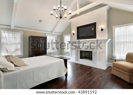 Luxury master bedroom with fireplace - stock photo