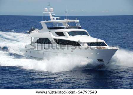 Luxury mega-yacht under way - stock photo