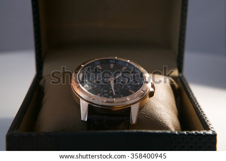 luxury men's watch in a gift box - stock photo