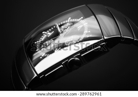 Luxury mens chronograph watch made of black high-tech ceramics on black background. Closeup studio photo with selective focus - stock photo
