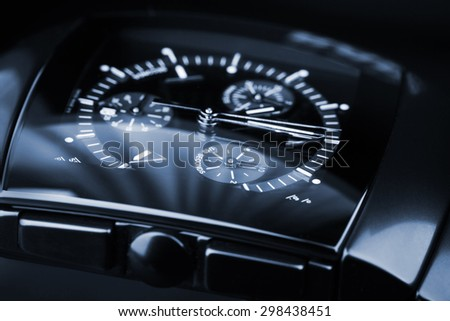 Luxury mens Chronograph Watch made of black high-tech ceramics with sapphire glass. Close-up blue toned studio photo with selective focus - stock photo