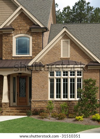 Luxury Model Home Exterior with front door bay window - stock photo