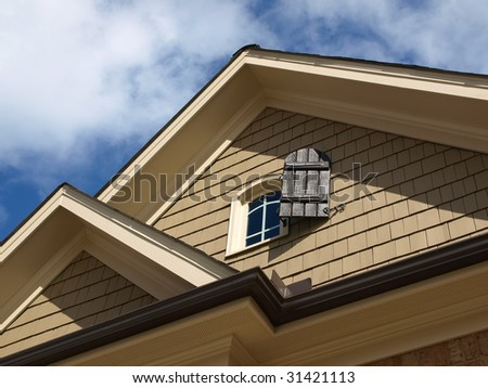 Luxury Model Home Exterior with window attic close up