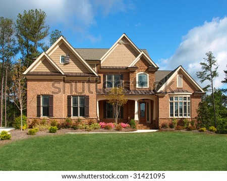Luxury Model Home Exterior with yard front view - stock photo