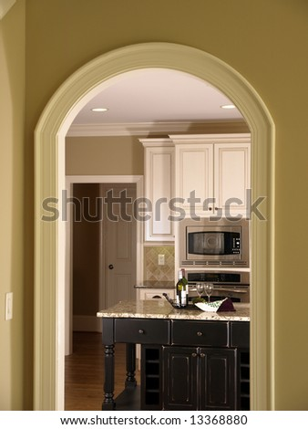 Luxury Model Home Kitchen Through Arch Door