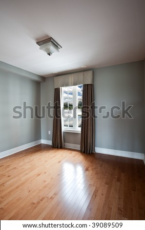 Luxury model home window coverings using wrought iron rods and side panels - stock photo