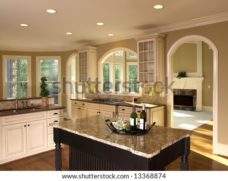 Luxury Model Home with Kitchen Island - stock photo