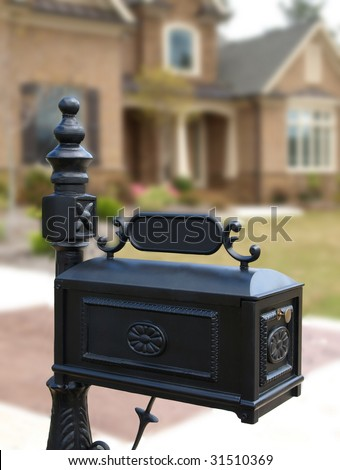 Luxury Model Home with Ornate Black Mailbox - stock photo