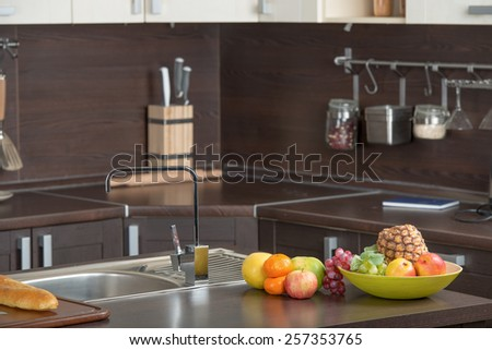 Luxury modern kitchen with faucet in the foreground - stock photo