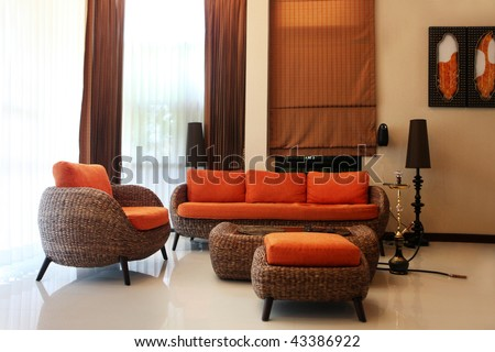 Luxury modern living room. predominantly orange color - stock photo
