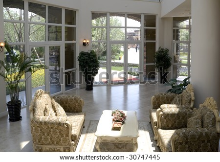Luxury modern living room with big windows