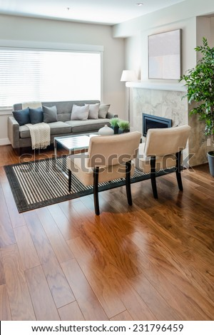 Luxury modern living suite, room with sofa and chairs and nicely decorated with vase coffee table. Interior design of a new house. Vertical. - stock photo