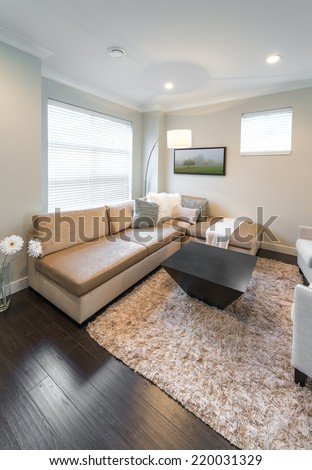 Luxury modern living suite, room with sofa, coffee table and chairs. Interior design of a brand new house. Vertical. - stock photo