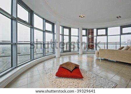 luxury modern penthouse apartment with floor to ceiling windows and panoramic views - stock photo
