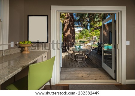 Luxury modern styled kitchen with granite counter and french doors leading to outdoors.  - stock photo