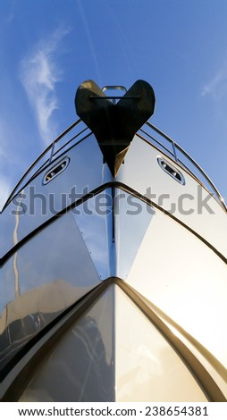 Luxury motor yacht beached at a dock for service and repair  - stock photo