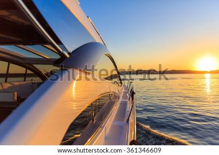 luxury motoryacht at sunset - stock photo