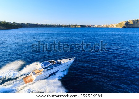 luxury motoryacht in  navigation - stock photo