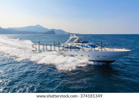 luxury motoryacht in navigation - stock photo