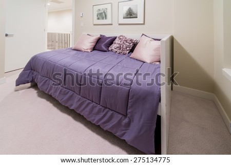 Luxury nicely decorated modern bedroom.  Interior design of a brand new house. - stock photo