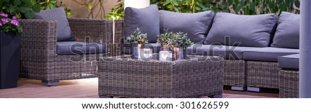 Luxury patio with modern furniture and romantic atmosphere - stock photo
