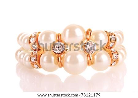Luxury pearl bracelet on whie background - stock photo