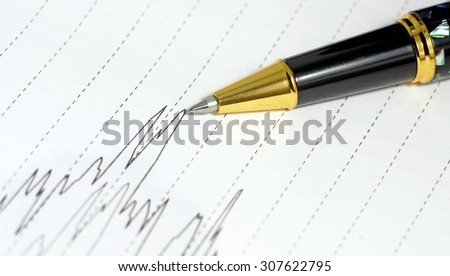 Luxury Pen on a paper with stock exchange graph. Money and business concept . copy space
