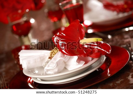 Luxury place setting in red and white  for Christmas or other event - stock photo
