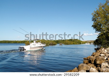 Luxury pleasure boat coming back from a leisure trip - stock photo