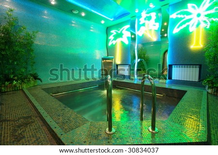 Luxury pool in modern hotel - stock photo