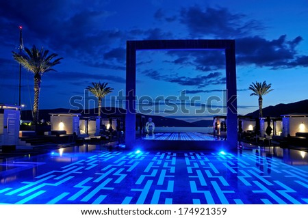 Luxury pool sunset - stock photo