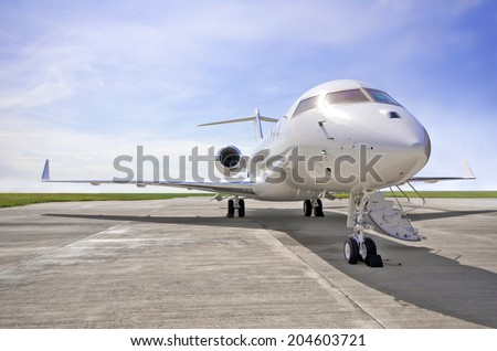 Luxury Private Jet Airplane for business flights - Side view - stock photo