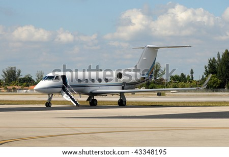 Luxury private jet awaiting passengers - stock photo