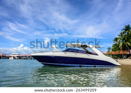 Luxury private speed boat wait a tourists near the coast - stock photo